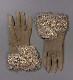 Pair of gloves | Museum of Fine Arts, Boston - Dark brown leather with cuffs of silver and gilt-silver yarns, silver spangles and fancy wires embroidered on linen ground; metal lace trim. Good condition; several metallic wires worn away. Late 16th century.