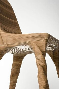 """Erosio Chair by Hermann August Weizenegger    """"German designer Hermann August Weizenegger has created the Erosio chair as part of a group of works where Weizenegger worked together with traditionally trained craftsmen and programmers aided by data-based procedures. The aesthetic concept behind the work lies somewhere between functional design product and autonomous object."""""""