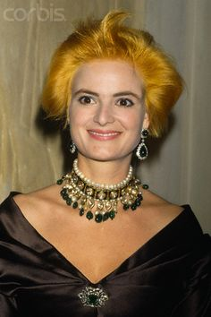Punk Princess Gloria wearingAn Indian style diamond, pearl and emerald choker, emrald brooch and impressive ear pendants