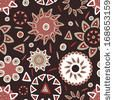 Hand drawn bright ethnic seamless pattern in terracotta tones. Abstract tribal endless background by Annareichel, via Shutterstock