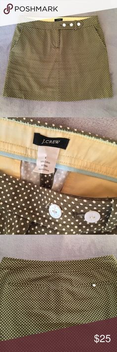 """J Crew polka dot miniskirt Cute cotton canvas mini skirt in olive green with creamy white colored polka dots. Three white nautical anchor buttons. Perfect for long summer days at the yacht club. 😉 Pair just as well with little sandal heels as it does white canvas sneakers. 30"""" waist. Front zip. Side and back pockets (see third pic for back). Flawless condition. J. Crew Skirts Mini"""