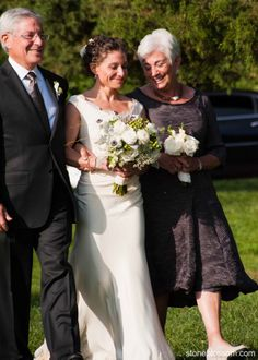Beautiful, blushing bride & her proud parents. And that bouquet!  @Stoneblossom Floral and Event Design