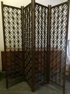 Lovely mid century modern four panel room divider folding screen is made of solid wood in an intricate, classic mid century design.  This room