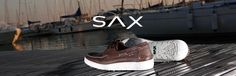 Dense sole, stylish design : SAX gives a breath of modernity to the traditional boat shoe. At the same time casual, chic and sportswear. In blue coloured leather, and white rubber sole. Italian product.