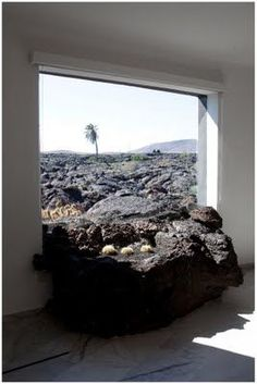 Cesar Manrique designed the window around the lava flow. Direct on you see the volcano itself and the flow coming towards you. Absolute class.