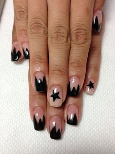 Black spiky with star gel nails