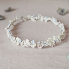 Handmade porcelain wildflower halo by Marie Canning. Part of the bridal floral accessories collection.