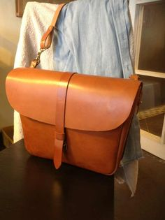 Simple, modern and clean. Stitches turned inside. Leather closure. Very nice!