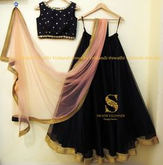 Beautiful black color designer lehenga and blouse with blush pink color net dupatta. Lehenga with broad golden boarder. Designer blouse with hand embroidery mirror and zardosi work. Black Lehenga, Indian Lehenga, Indian Gowns, Indian Attire, Lehenga Choli, Indian Outfits, Indian Clothes, Dresses To Wear To A Wedding, Party Wear Dresses
