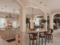 French Colonial Kitchen Design Ideas with Emblematic Arches and Intricate Woodwork.....great layout!