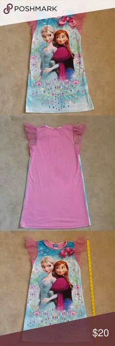 Girl's Disney Frozen Nightgown Girl's Disney Frozen Nightgown With pink bow.  Sheer pink sparkle cap sleeves. 100 % polyester.   Excellent condition. No rips, stains, or imperfections. Smoke free house.   Reasonable offers are accepted and I discount bundles. Disney Pajamas Nightgowns