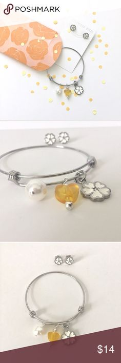 Relisted🌼 stainless steel daisy jewelry set Stainless steel earrings & stainless steel bracelet ✨ adjustable bracelet✨charms have silver tone findings *flower charm is stainless steel as well* 💖 bundle•make an offer•save on shipping💖 perfect for a gift handmade Jewelry Bracelets
