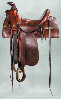 Main & Winchester Half-Seat Saddle A circa 1880s, half-seat saddle with attached side jockeys and full double rigging. Cheyenne roll, Sam Stagg rig with rawhide laces. Nice color, some restoration, overall very good. Nice clear cartouche on the fender. Provenance: From the Estate of Thomas W. Lorimer. (Est $1,500-2,000) Will be offered at auction in Fort Worth, TX on 6/10/17