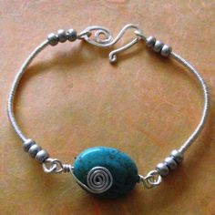 bracelet displays a lovely oval turquoise bead