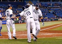 Infielder Ryan Roberts #19 of the Tampa Bay Rays celebrates with catcher Jose Molina #28 after his home run against the Toronto Blue Jays during the game at Tropicana Field on September 22, 2012 in St. Petersburg, Florida.