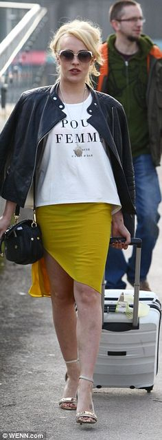 Leggy look: The former Hollyoaks actress showed off her tan in a mustard coloured skirt wi...