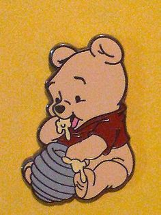 Young-Winnie-the-Pooh-sitting-eating-honey-from-a-hive-Disney-Trading-Pin