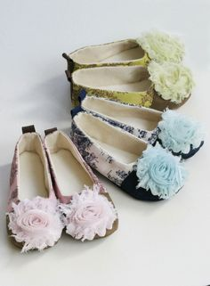 Charming Toile print, in your choice of pink and brown, navy and white, or green and brown, canvas, make these slippers perfect for a wedding, garden or tea parties, or just a stroll in the park. The loop at the back makes it easy to convert from a flat to a traditional ballet slipper. (34.00)