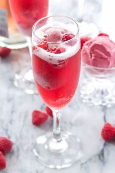 Raspberry Sorbet Bellinis   3 ingredients is all you need to make these pretty and delicious cocktails!