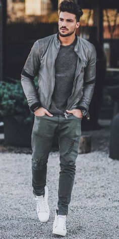 - with a monochrome fall outfit with a gray motorbike leather jacket black sweatshirt wrist accessories black banded watch distressed gray denim white sneakers Casual Street Style, Style Casual, Men Casual, Guy Style, Men's Style, Casual Wear, Mens Fashion Blog, Look Fashion, Fashion Edgy