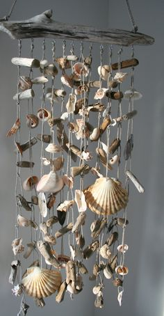 Crafts Shells Unique Sea Shell Craft DIY Ideas You Will Love Unique Sea Shell Craft DIY Ideas You Will approach to renovate your house without a big expense is to update the flooring. Seashell Wind Chimes, Diy Wind Chimes, Seashell Art, Seashell Crafts, Beach Crafts, Home Crafts, Diy Crafts, Nature Crafts, Seashell Mobile