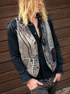 A mens tweed vest upcycled with a variety of repurposed tweed, hand stitched detailing, mismatched buttons and renewed pockets.  Back of vest also has some patchy action ;)  Mens size XLarge.  Across Chest - 42 Length - 27 (from nape of neck to longest point in front)