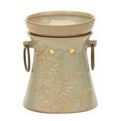 Soft, fluid lines; reactive glaze finish in shades of warm taupe and pale, watery blue and green; and decorative metal accents combine to create a peaceful, spa-like warmer different from any other. Candle Wax Warmer, Bamboo Design, Scented Wax, Scentsy, Fragrance, Stuff To Buy, Decorative Metal, Metal Accents, Glaze