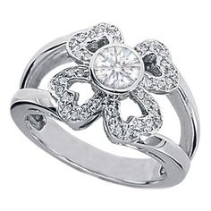 This flower engagement ring features twenty-four round brilliant cut diamonds pave set in multiple hearts as a flower accenting a bezel set round diamond carat in 14 karat white gold. Diamond Flower, Diamond Heart, Heart Ring, Engagement Ring Styles, Designer Engagement Rings, Jewelry Rings, Jewelery, Halo Rings, Ring Designs