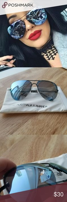 QUAY X AMANDA MUSE IN BLACK/PURPLE I personally always felt like these were more of a blue than a purple, but that's the official color! Black/Purple. I've decided I like larger frames so I'm selling my muse collection. Good used condition, no significant signs of wear that I was able to detect. Pouch is white so it may not be in mint condition. Quay Australia Accessories Glasses