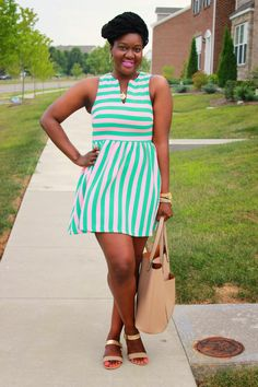 gold sandals, colorful/striped dress.
