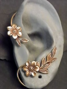 Flower and Leaf Ear Wrap - GOLDEN GARDEN - Brass Ear Cuff Wrap. $38.95, via Etsy.