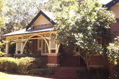Federation Bungalow style, Australia - checkout the porch columns and arch and also the interesting window with the center section lower than the sidelights.