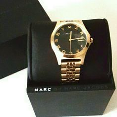 (NWT) Marc Jacobs gold 'Slim' watch This Marc by Marc Jacobs watch features a beautiful black face with a contrasting gold band/face. This timeless piece would be the perfect compliment to any woman's wardrobe. New, never worn. Marc by Marc Jacobs Accessories Watches