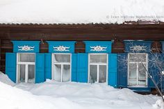 Windows covered with snow in Alapaevsk