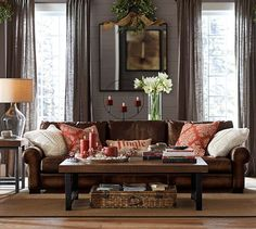 Iron and glass table to lighten room- love the leather sofa for ...