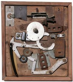 John Bernhardt   think about typewriter parts and attached to wood