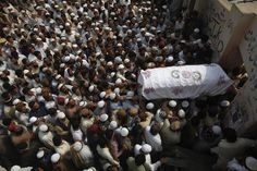 Supporters of Jamiat-Ulema-e-Islam (JUI), one of the largest Sunni political parties, and Ahl-i-Sunnat Wal Jamaat (ASWJ), a political and religious group, carry the casket of one of the two workers who had been shot by unidentified gunmen a day earlier, during funeral prayers in Karachi February 19, 2013. At least eight persons were killed and seven others injured