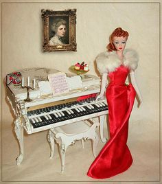 Beautiful!  I had this...and might still have it, although it was WELL played with, and therefore, not in good shape. Vintage Barbie Piano