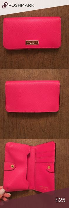 Henri Bendel Phone Wallet Henri Bendel Phone Wallet in pink. Snap closure. Practically new. Perfect for holding your phone, credit cards and cash! henri bendel Bags Wallets
