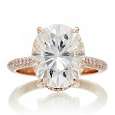 As shown on images is the 12x10 which is now discontinued as well as the 11x9 oval Moissanite.