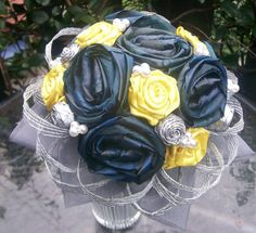 Hand dyed and woven blue flax roses with yellow satin roses and silver plaited flax buds. Accented with pearls and silver flax netting Satin Roses, Satin Flowers, Flax Flowers, Plaits, Flower Bouquet Wedding, Floral Arrangements, Wedding Planning, Weaving, Blue