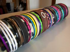 Brittany's Secret: Headband Holder--DIY. All you need is a bath towel, fabric and large binder clips.