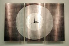 Original Metal Wall Art Clock Handcrafted by statements2000, $300.00. A very different clock.