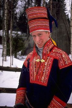 A young Laplander wears a traditionally handcrafted, furlined hat and embroidered sweater to protect against Arctic weather in northern Rovaniemi, Finland.
