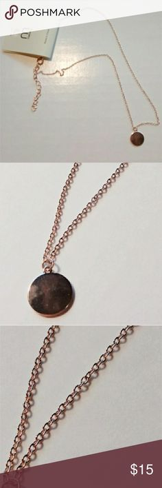 Disc Chain Necklace ~Measures Approx. 19 inches Clasp to Clasp The color is rose gold. Delicate chain necklace with small smooth metal disc pendant. A simple yet chic finishing touch to anything from a casual day look to a stylish night out with the girls! Features adjustable chain and lobster clasp closure. Melody Jewelry Necklaces