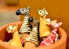 Hand carved Wine Toppers from Kenya - One of our favorite new items from Ten Thousand Villages - fair trade - gifts