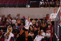 #Elon outside hitter Megan Gravley winds up before crushing the ball in a volleyball match during the fall of 2013.