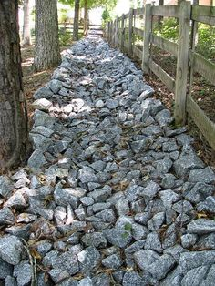 How to build a granite rip-rap lined drainage swale on a steep backyard.