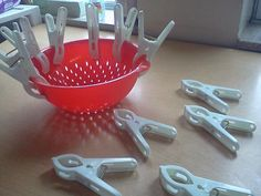 fine motor activity-strainer & large clips from Dollar Tree. My preschool kids love this!
