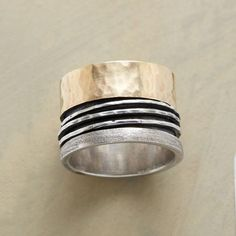 14k and sterling silver wide spinner ring.
